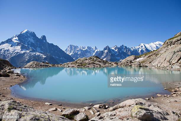majestic mont blanc massif reflected in lac blanc - mont blanc massif stock photos and pictures