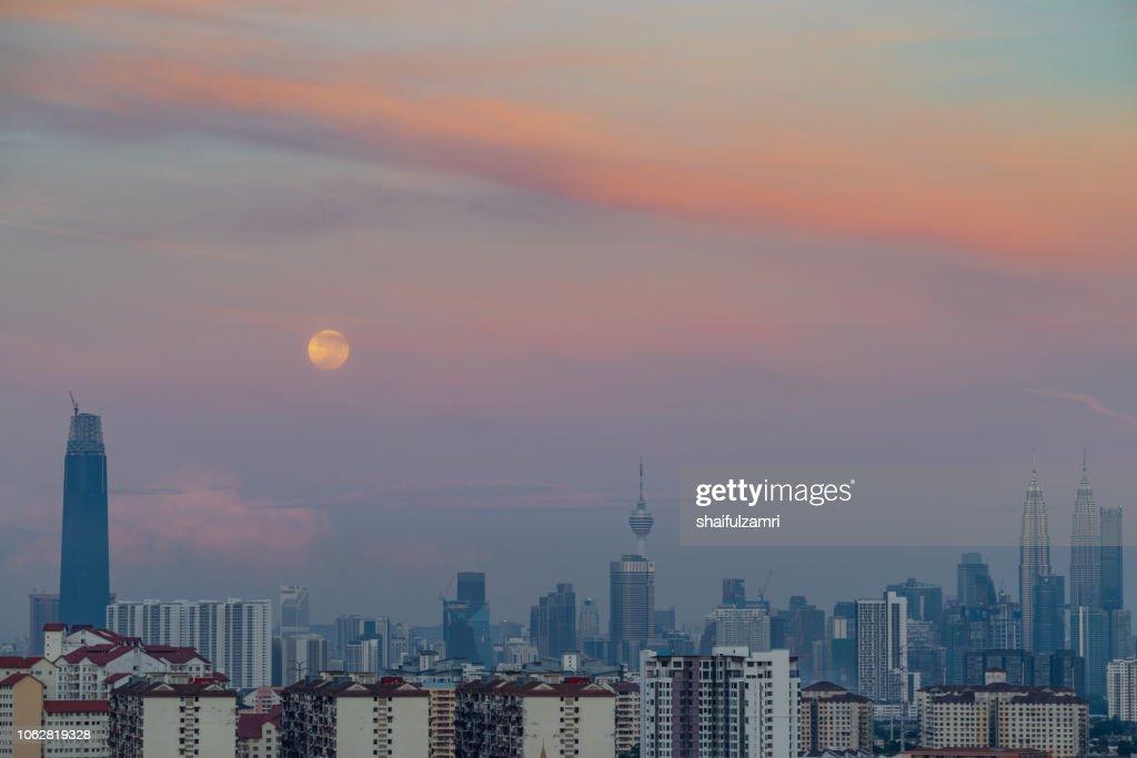 Majestic moon set  over downtown Kuala Lumpur, Malaysia. : Stock Photo