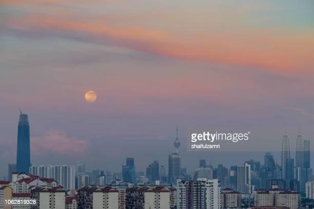 Majestic moon set  over downtown Kuala Lumpur, Malaysia.