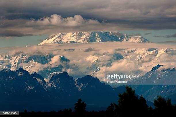 Majestic Mount Denali soars above the clouds in Alaska