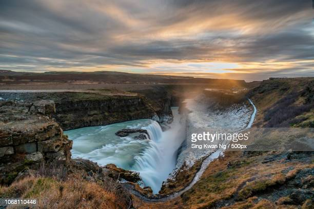 majestic natural scenery of gullfoss waterfall at sunset - gullfoss falls stock photos and pictures