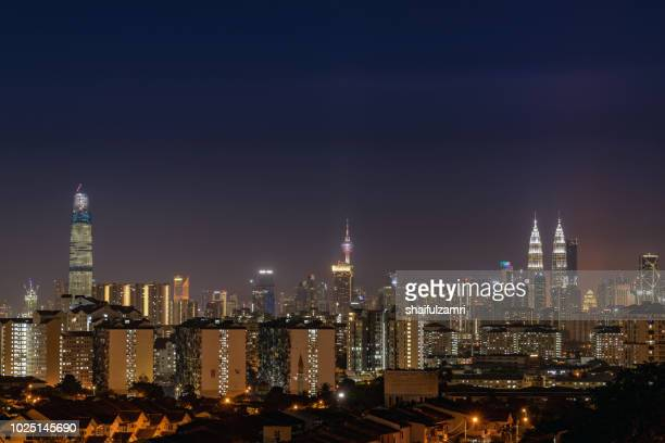 majestic night skyline of downtown kuala lumpur, malaysia. - shaifulzamri stockfoto's en -beelden