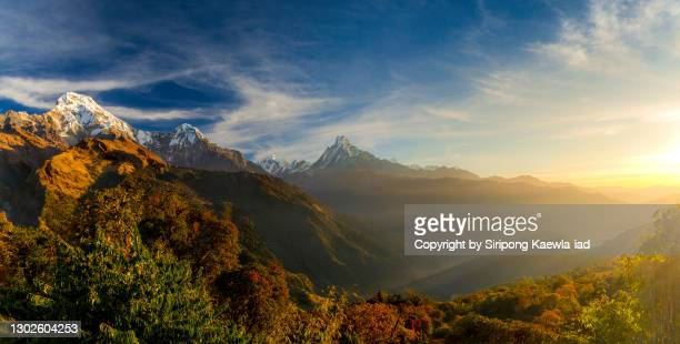 a majestic panoramic view of mt. annapurna south, hinchuli and machapuchhre at sunrise from tadapani village, nepal. - annapurna south stock pictures, royalty-free photos & images