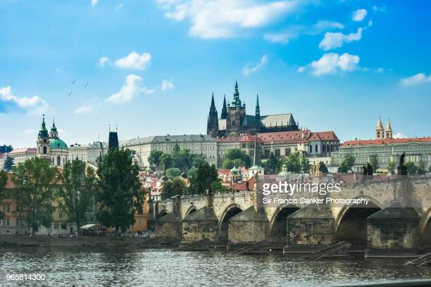 majestic prague skyline with hradcany castle, st. vitus cathedral and monumental charles bridge over vltava river in czech republic, a unesco heritage site - vltava river stock photos and pictures