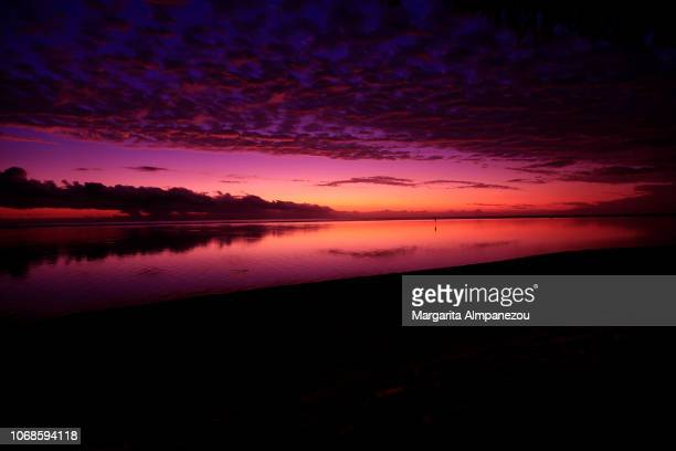 Majestic purple cloud sky reflecting in the sea