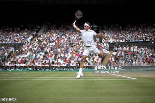 A majestic Roger Federer of Switzerland in action against Marin Cilic of Croatia during the Gentlemen's Singles final of the Wimbledon Lawn Tennis...