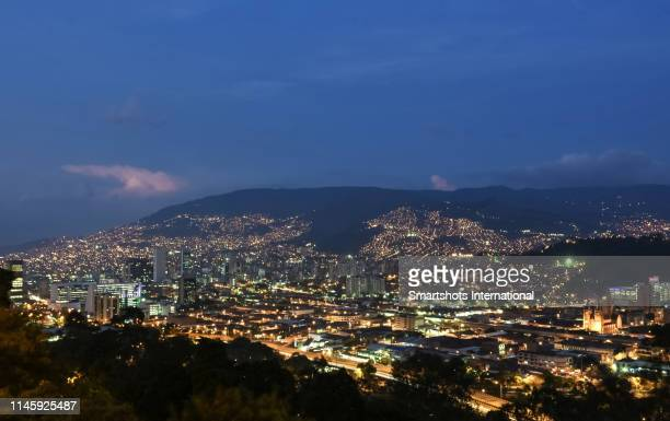 majestic skyline of medellin illuminated at dusk with skyscrapers and light trails in antioquia, colombia - コロンビア メデジン ストックフォトと画像