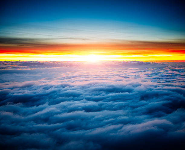 majestic sunrise above clouds