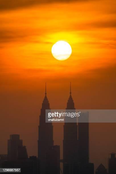 majestic sunrise over downtown kuala lumpur, a capital of malaysia. - shaifulzamri stock pictures, royalty-free photos & images