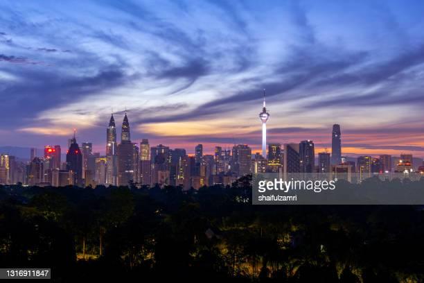 majestic sunrise over downtown kuala lumpur, a capital of malaysia - shaifulzamri stock pictures, royalty-free photos & images