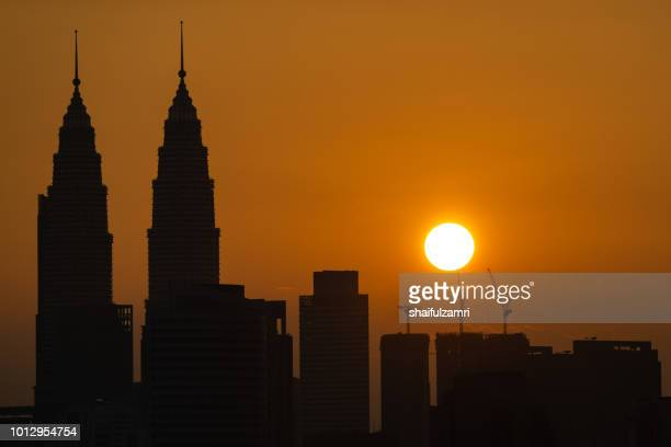majestic sunrise over downtown kuala lumpur, malaysia. - shaifulzamri stock pictures, royalty-free photos & images
