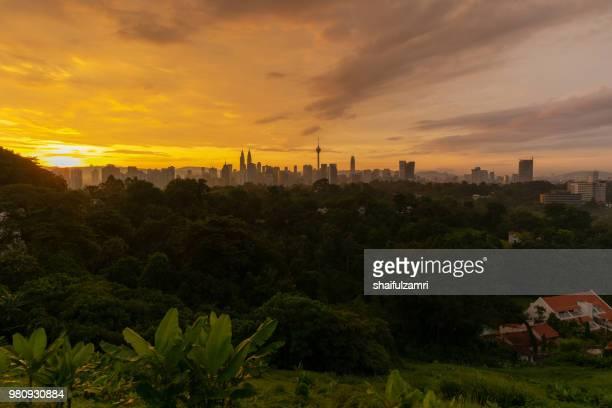 majestic sunrise over downtown kuala lumpur, malaysia - shaifulzamri stock pictures, royalty-free photos & images
