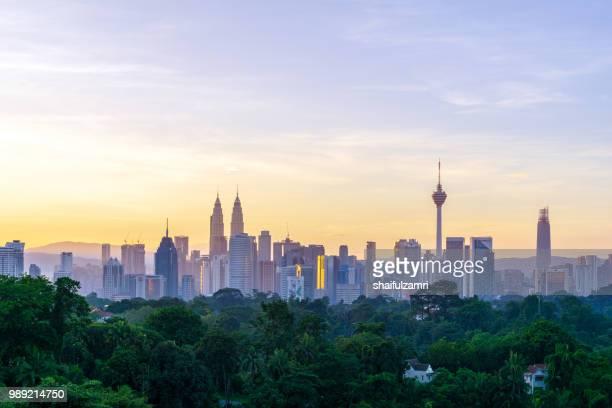majestic sunrise over downtown kuala lumpur, malaysia - kuala lumpur stock pictures, royalty-free photos & images