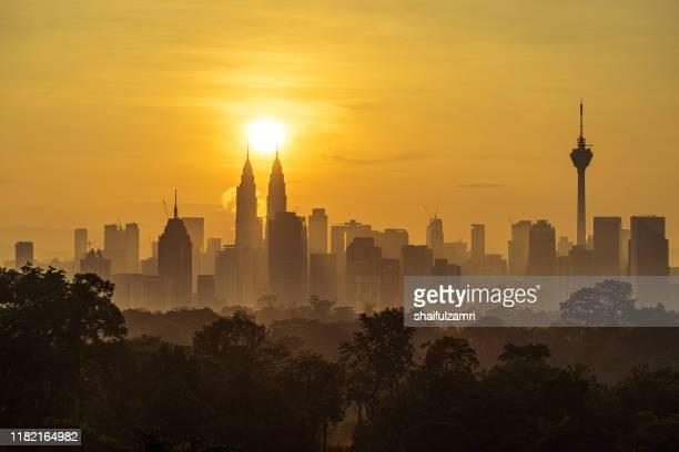 majestic sunrise over downtown kuala lumpur - shaifulzamri stockfoto's en -beelden