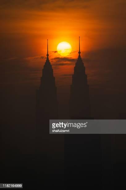 majestic sunrise over downtown kuala lumpur - shaifulzamri stock pictures, royalty-free photos & images