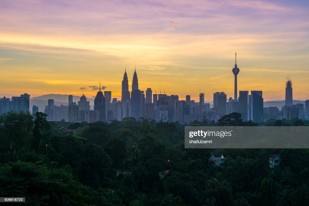 Majestic sunrise over Petronas Twin Towers and surrounded buildings in downtown Kuala Lumpur, Malaysia : Stock Photo