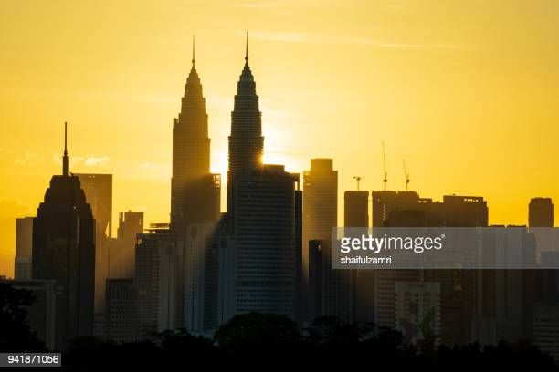 majestic sunrise over petronas twin towers and surrounded buildings in downtown kuala lumpur, malaysia - shaifulzamri stock pictures, royalty-free photos & images