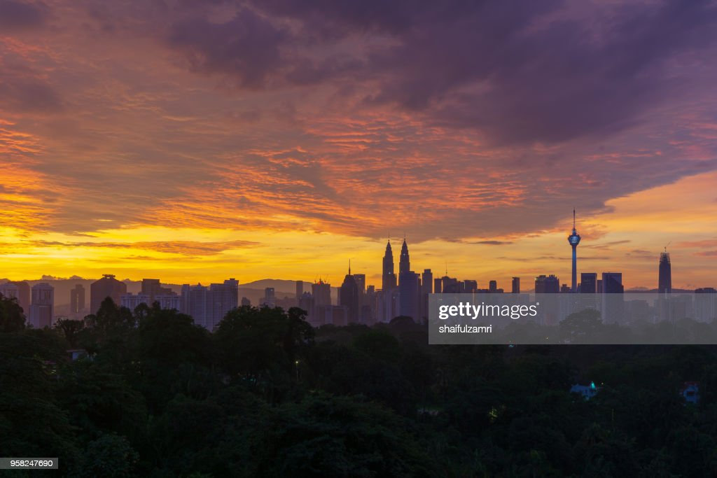 Majestic sunrise over Petronas Twin Towers and surrounded buildings in downtown Kuala Lumpur, Malaysia. : Stock Photo