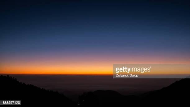 majestic sunrise over the mountains - horizon over land stock photos and pictures