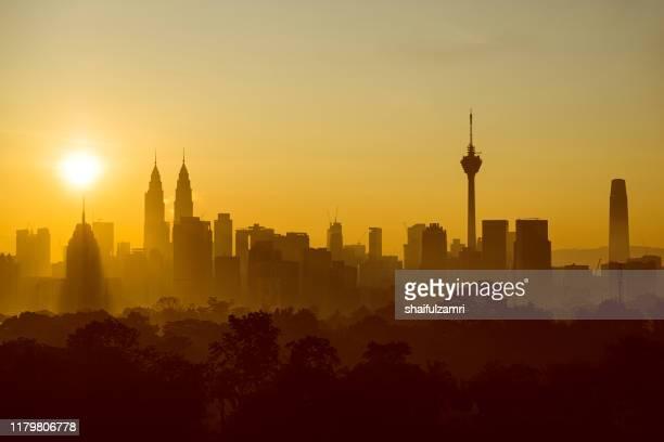 majestic sunrise view over downtown kuala lumpur. - shaifulzamri stock pictures, royalty-free photos & images