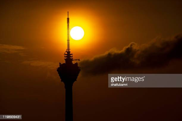 majestic sunrise view over kuala lumpur tower. - shaifulzamri stock pictures, royalty-free photos & images