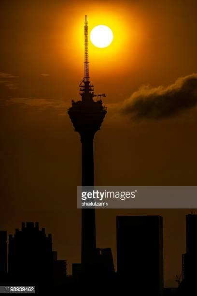 majestic sunrise view over kuala lumpur tower. - shaifulzamri stock pictures, royalty-free photos & images