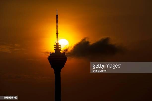 majestic sunrise view over kuala lumpur tower. - shaifulzamri stock-fotos und bilder