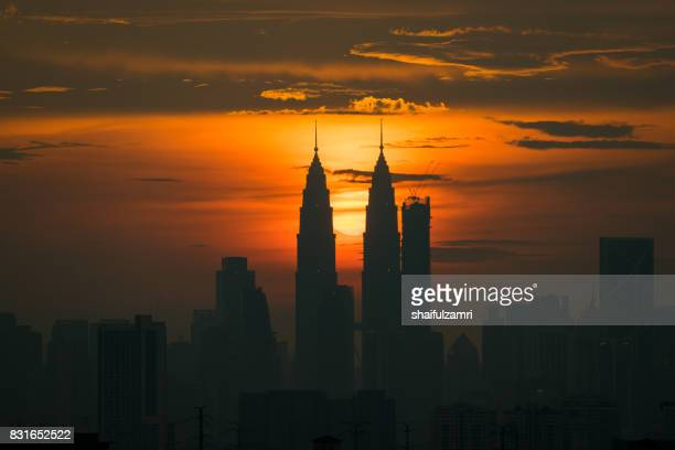 Majestic sunset in Kuala Lumpur, the capital of Malaysia. Its modern skyline is dominated by the 451m-tall KLCC, a pair of glass-and-steel-clad skyscrapers.