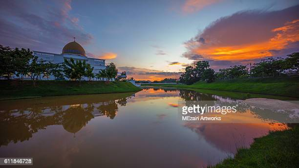 Majestic Sunset Over a Mosque by the lake with perfect reflection