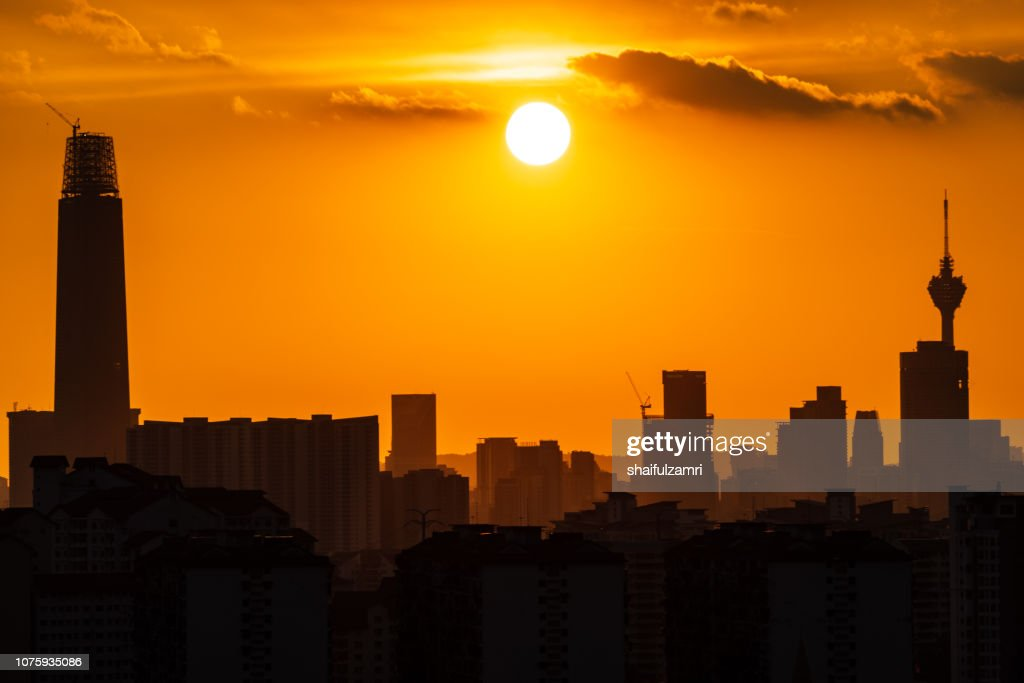 Majestic sunset over downtown Kuala Lumpur in silhouette. : Stock Photo