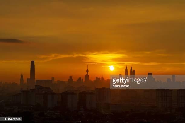 majestic sunset over downtown kuala lumpur - shaifulzamri stock pictures, royalty-free photos & images