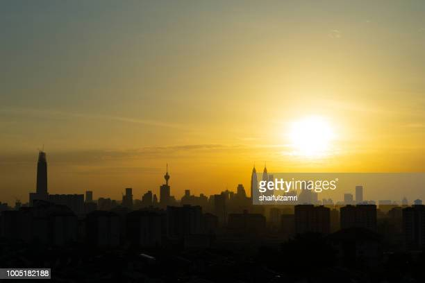 majestic sunset over kl tower and surrounded buildings in downtown kuala lumpur, malaysia. - shaifulzamri foto e immagini stock