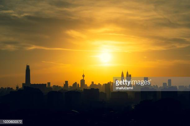 Majestic sunset over KL Tower and surrounded buildings in downtown Kuala Lumpur, Malaysia.