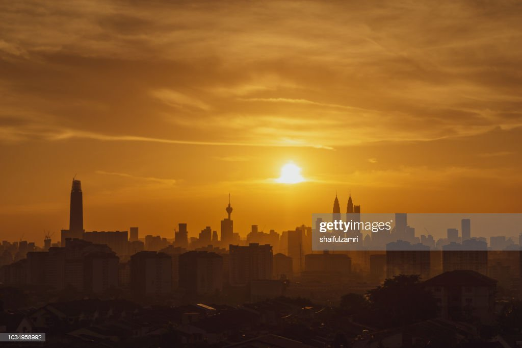 Majestic sunset over KL Tower and surrounded buildings in downtown Kuala Lumpur, Malaysia. : Stock Photo