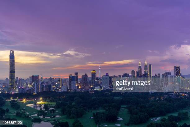 Majestic sunset over Kuala Lumpur, capital of Malaysia. Its modern skyline is dominated by the 451m tall KLCC, a pair of glass and steel clad skyscrapers.