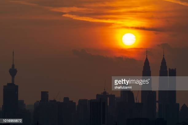 majestic sunset over twin towers and surrounded buildings in downtown kuala lumpur, malaysia. - shaifulzamri stock pictures, royalty-free photos & images