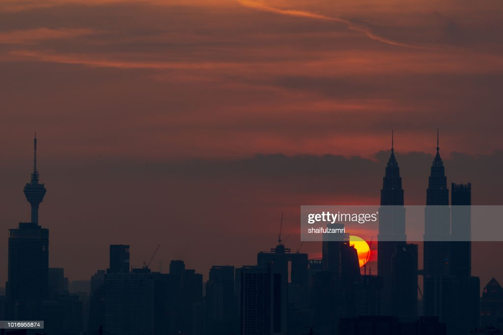 Majestic sunset over Twin Towers and surrounded buildings in downtown Kuala Lumpur, Malaysia. : Stock Photo