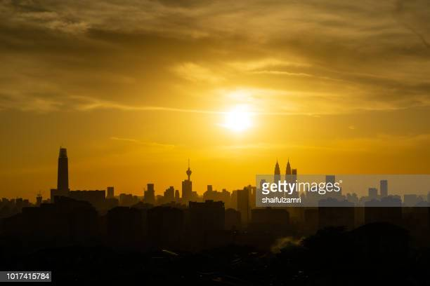 Majestic sunset over Twin Towers and surrounded buildings in downtown Kuala Lumpur, Malaysia.