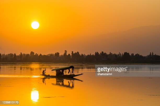 majestic sunset view over dal lake in kashmir, india - shaifulzamri stock pictures, royalty-free photos & images