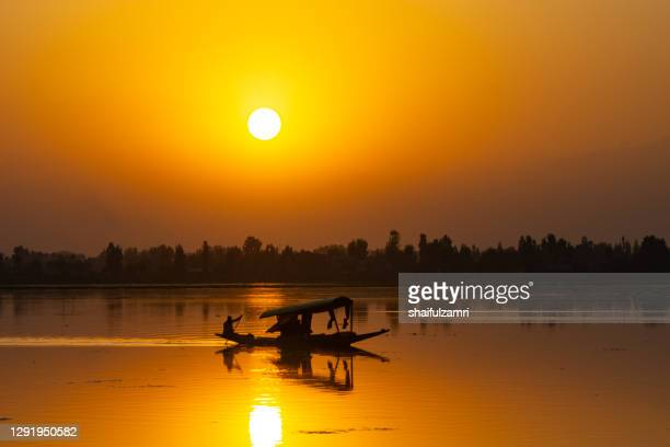 majestic sunset view over dal lake in kashmir, india. - shaifulzamri stock pictures, royalty-free photos & images