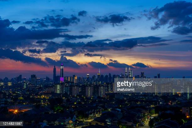 majestic sunset view over down town kuala lumpur, malaysia. - shaifulzamri stock pictures, royalty-free photos & images
