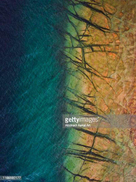majestic textures on the shoreline of lake garda as seen from directly above, italy - lake bed stock pictures, royalty-free photos & images