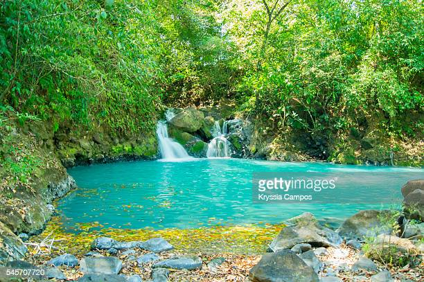 Majestic turquoise waters river hidden at rainforest