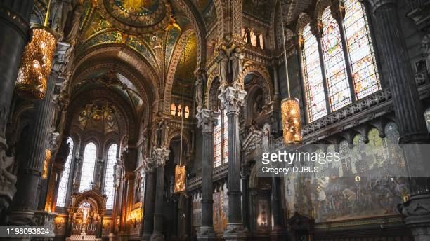 majestic very decorated and golden interior of the basilica notre dame de fourviere in lyon french city - cathedral stock pictures, royalty-free photos & images