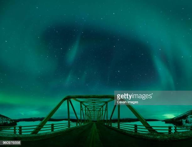 Majestic view of aurora borealis over Alaska Highway Bridge