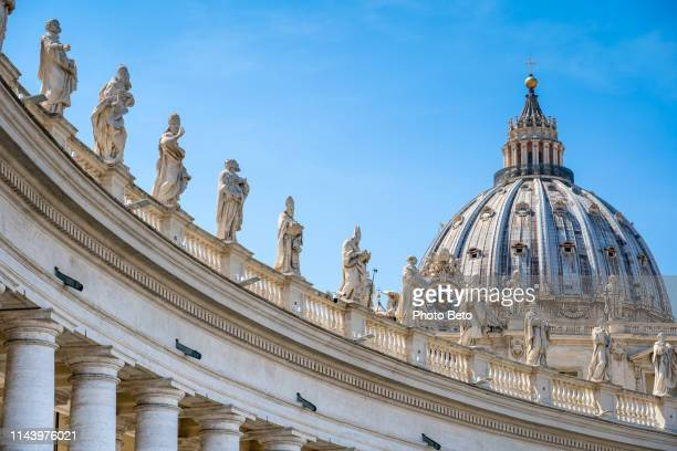 a majestic view of bernini's colonnade in the square of st. peter's basilica in rome - vatican stock pictures, royalty-free photos & images