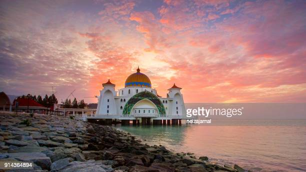 majestic view of malacca straits mosque during sunset - historical istanbul stock pictures, royalty-free photos & images