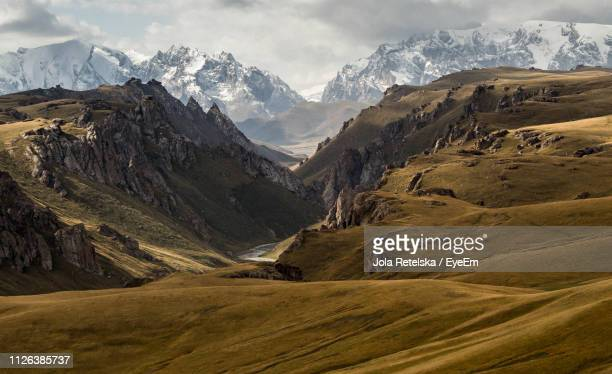 majestic view of snowcapped mountains - kyrgyzstan stock pictures, royalty-free photos & images
