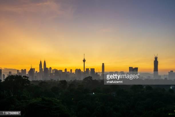 majestic view of sunrise over downtown kuala lumpur, malaysia. - shaifulzamri bildbanksfoton och bilder