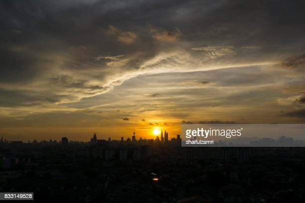 majestic view of sunset in downtown kuala lumpur, malaysia - shaifulzamri stock pictures, royalty-free photos & images